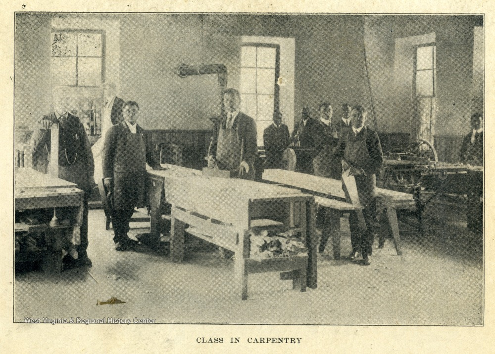African-American students pose for a photograph in their carpentry classroom.