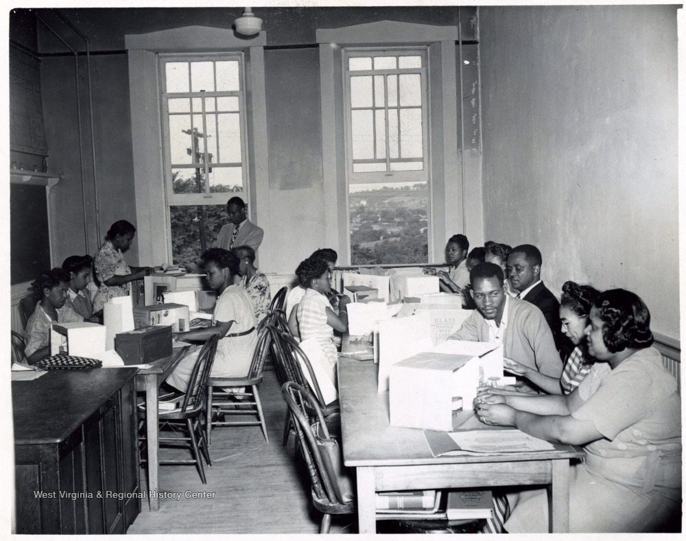African-American students work on models in a classroom.
