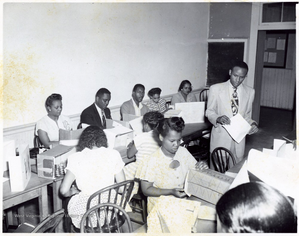 African-American students and instructor, T. W. Stanback, in class working on models.