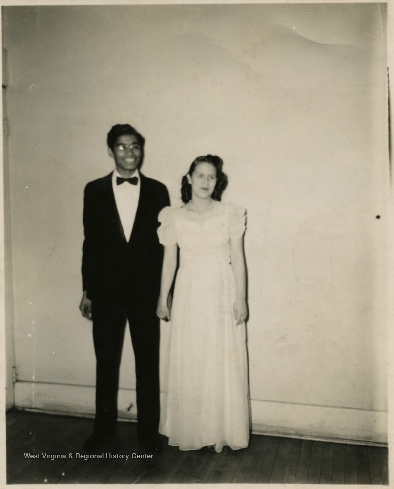 Male and female students in formal clothing.