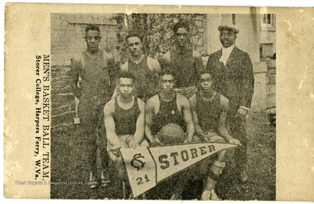 A post card with a group photo of the Men's Basketball team in uniform.