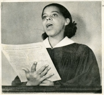 African-American student, Marion Virginia Johnson Reeler, holding sheet music and singing.