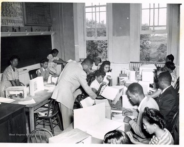 African-American students and instructor, T. W. Stanback, working with models in class.
