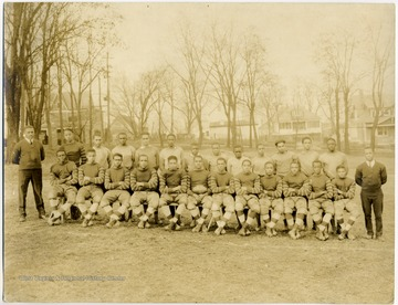 Group portrait of 'Golden Tornado' football team from African-American school, Storer College.