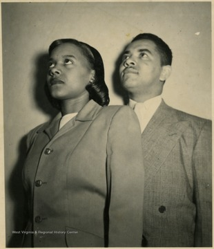 A male and female student pose for a portrait.