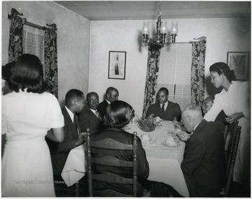 Richard I. McKinney sits at the far end of the table.