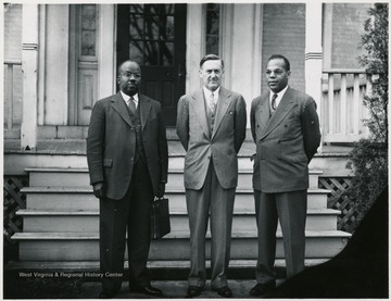 President Richard McKinney at right.