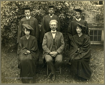 Five 1924 graduates with Pres. (Dr.) McDonald. First Row: Madison S. Briscoe, Robt. S. Chase, Geo B. Toodle. Second Row: Florence A. Warfield, Dr. McDonald, Anna K. Campbell.