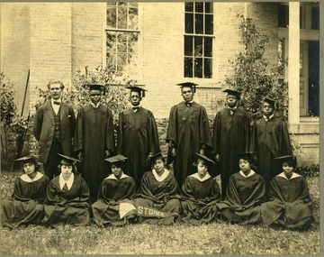 Group shot of the 1920 graduates in caps and gowns. First Row: Pres. McDonald, Harris, Clark, Lee, Walker, Redman. Second Row: Parker, Freeman, Airington, Snowden, Harmon, Scott, Wildy.