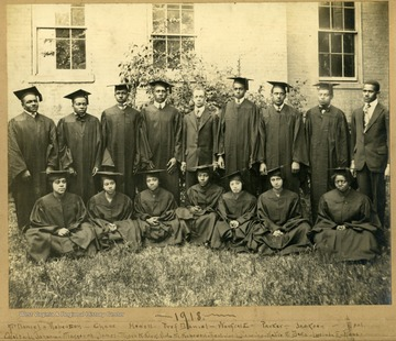 Group photo of Storer College graduates, class of 1918, in caps and gowns in front of building. First Row: McDaniel, Robertson, Case, Howell, Prof. Daniel, Warfield, Parker, Jackson, Neal. Second Row: Odetta Johnson, Margaret James, Myra McKirk, Vida McHipewell, Beatrice Calloway, Katie McDavis, Lucinda E. Ross.