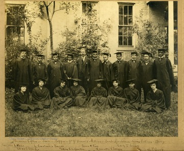 Group photo of Storer College graduates in caps and gowns in front of building on the lawn. First Row: Harmon, Cephas, Jones, Pres. McDonald, Willims, Dandridge, Johnson, Goens, Nickerson, Busly. Second Row: Margaret L. White, Lillian L. Eldridge, L. Constantia Frazier, Lillian E. L. Hamilton, Grace W. Rose, Henrietta V. Freeman, Emily F. Crump, Elizabeth F. Crump.