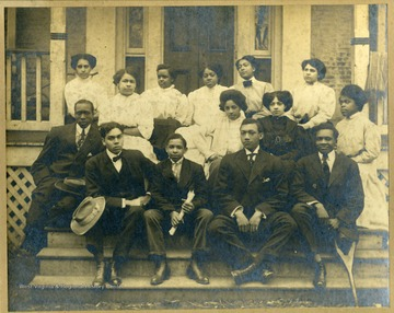 Group photo of Storer College class of 1909 sitting on front steps of building on Storer College campus.