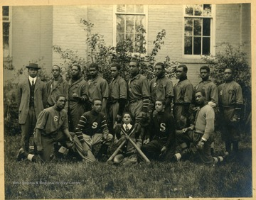 Group photo of Storer College baseball team in uniform. First Row: Myers (Mgr), Lewis (2ndB), Tomlinson, Fisher (Lf), Morris (3rdB), Harvey (1stB), Diggs (C), Scott (SS), Arte (CF), Hill (RF). Second Row: Tindley, Harris, Delaney, (mascot with bats), Reese, King.