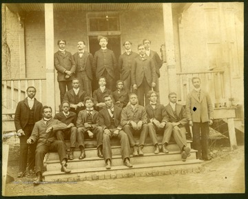 Group photo of Storer College YMCA Group taken on front steps and porch of building. Pres. McDonald in back row.